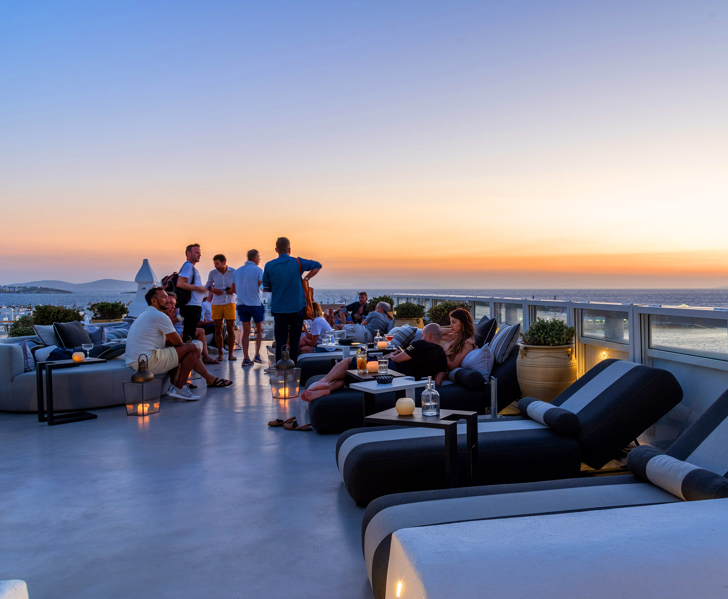 The TownHouse SKYBAR Roof top photo of friends enjoying the sunset