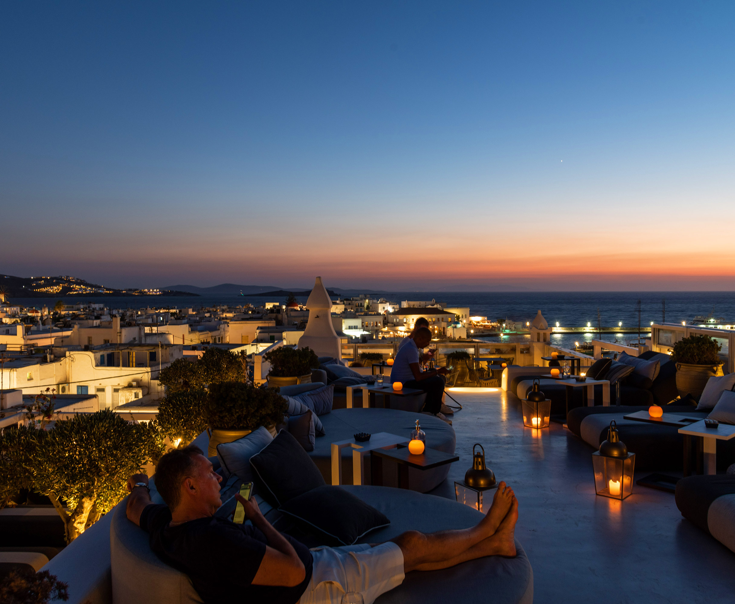 The TownHouse SKYBAR Roof top photo of man relaxing